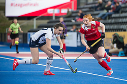 Holcombe's Lucy Wood goes round Miranda Caillard of East Grinstead. East Grinstead v Holcombe - Semi-Final - Investec Women's Hockey League Finals, Lee Valley Hockey & Tennis Centre, London, UK on 22 April 2017. Photo: Simon Parker