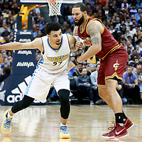 22 March 2017: Cleveland Cavaliers guard Deron Williams (31) defends on Denver Nuggets guard Jamal Murray (27) during the Denver Nuggets 126-113 victory over the Cleveland Cavaliers, at the Pepsi Center, Denver, Colorado, USA.