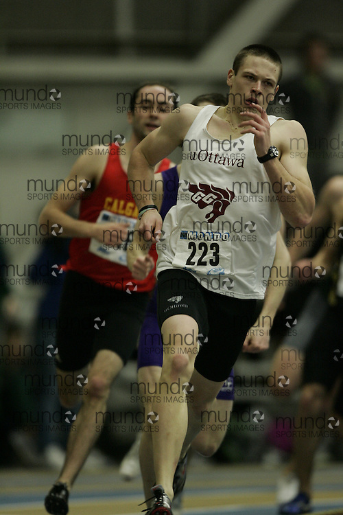(Windsor, Ontario---13 March 2010) Michael Robertson of University of Ottawa Gee-Gees  competes in the mens 600 meters at the 2010 Canadian Interuniversity Sport Track and Field Championships at the St. Denis Center. Photograph copyright GEOFF ROBINS/Mundo Sport Images. www.mundosportimages.com