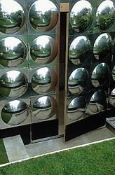 Door to workshop clad with aluminium disks. Design Diarmuid Gavin