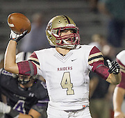 Rouse quarterback Billy McCrary in play action against Cedar Ridge Friday at Dragon Stadium.  (LOURDES M SHOAF for Round Rock Leader.)