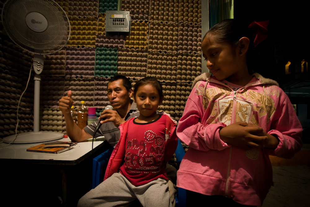 Efren Rios with his daughters Asusena and Isma Rubi. Rios who is a profession radio presenter also volunteers for the community radio in Petaquillas organised by FUSDEG. His programmes range in subjects such as health and well being, and literature.