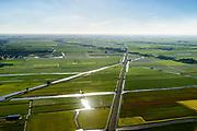 Nederland, Noord-Holland, Gemeente Koggenland, 13-06-2017; West-Friesland, spoorlijn Hoorn-Alkmaar ter hoogte van Bobeldijk en Berkhout, kruiiosng met SLimtocht.<br /> West-Frisia.<br /> luchtfoto (toeslag op standaard tarieven);<br /> aerial photo (additional fee required);<br /> copyright foto/photo Siebe Swart