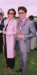MR & MRS ANDY WONG the wealthy Hong Kong businessman. at a polo match in Berkshire on 26th July 1998.MJG 70
