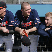 The University of Virginia's Adam Bleday, left, Connor Jones, center, and Artie Lewicki talk before their season opener against The University of Kentucky. The university of Kentucky faced the University of Virginia in the opening game of the Hughes Brothers Challenge Friday February 14, 2014 at Brooks Field on the campus of the University of North Carolina at Wilmington in Wilmington, N.C. (Jason A. Frizzelle)