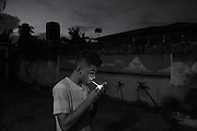 Zanzibar Town, Zanzibar -   2015-03-25  - A recovering addict takes a smoke break outside the Detroit Sober House for men in Zanzibar Town, Zanzibar on March 25, 2015.  Photo by Daniel Hayduk