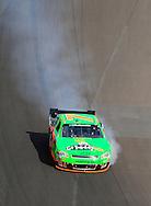 Nov. 12 2011; Avondale, AZ, USA; Smoke comes the car of NASCAR Nationwide Series driver Danica Patrick (7) during the Wypall 200 at Phoenix International Raceway. Mandatory Credit: Jennifer Stewart-US PRESSWIRE