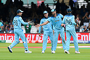 Liam Plunkett of England is congratulated by Jos Buttler of England after completing his 10 overs with 3 wickets during the ICC Cricket World Cup 2019 Final match between New Zealand and England at Lord's Cricket Ground, St John's Wood, United Kingdom on 14 July 2019.
