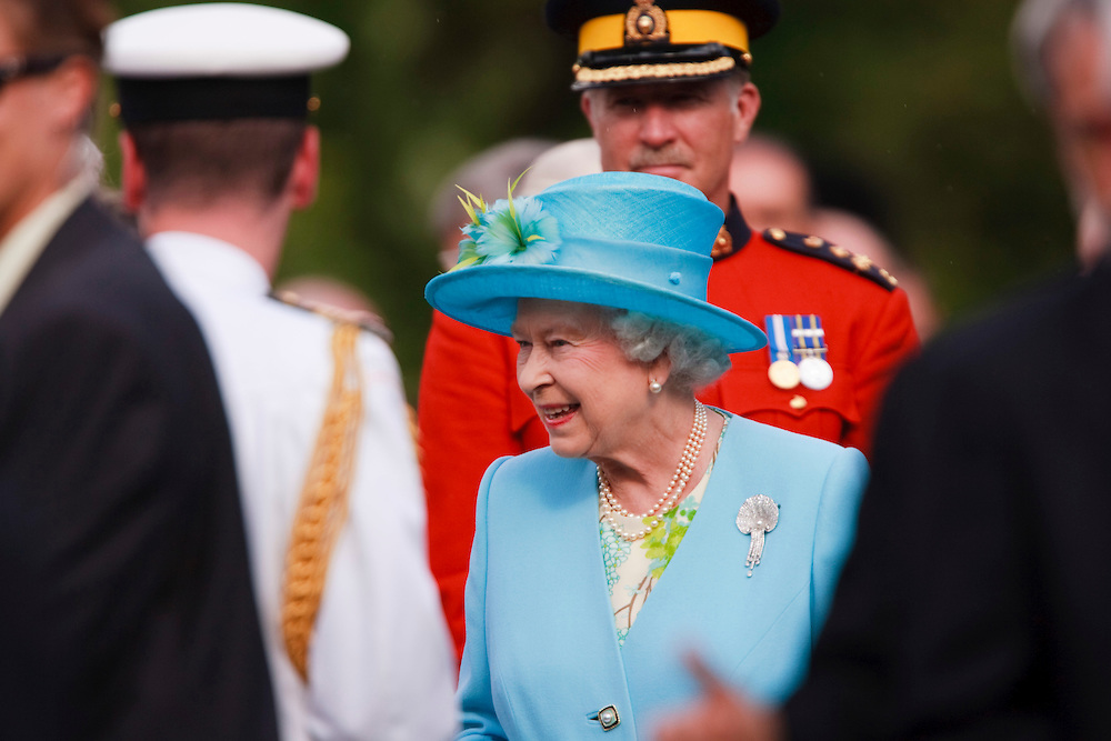 Queen Elizabeth greets the crowd at a garden reception  at Rideau Hall, the Queen's official residence in Ottawa, Canada, June 30, 2010. The Queen is on a 9 day visit to Canada. <br /> AFP/GEOFF ROBINS/STR