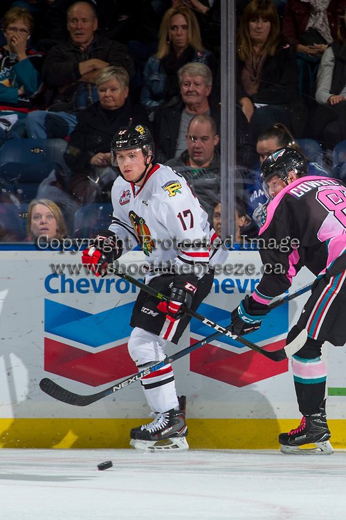 KELOWNA, CANADA - OCTOBER 21: Jack Cowell #8 of the Kelowna Rockets checks Alex Overhardt #17 of the Portland Winterhawks on October 21, 2017 at Prospera Place in Kelowna, British Columbia, Canada.  (Photo by Marissa Baecker/Shoot the Breeze)  *** Local Caption ***