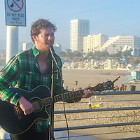 Pat Brosnan sings at the Santa Monica Pier on Tuesday, March 1, 2016.