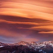 An image of a giant lenticular cloud above the Carson Range in the Sierra mountains. In August 2006 this lenticullar persisted for 3 days as the winds aloft were howling. Suffice it to saw that the sunsets were amazing.