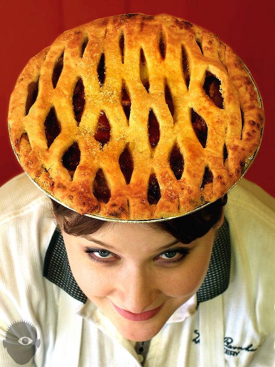 Stephanie Hayes of the Helen Bernhard Bakery on NE Broadway shows off a classic apple pie balanced on her head.