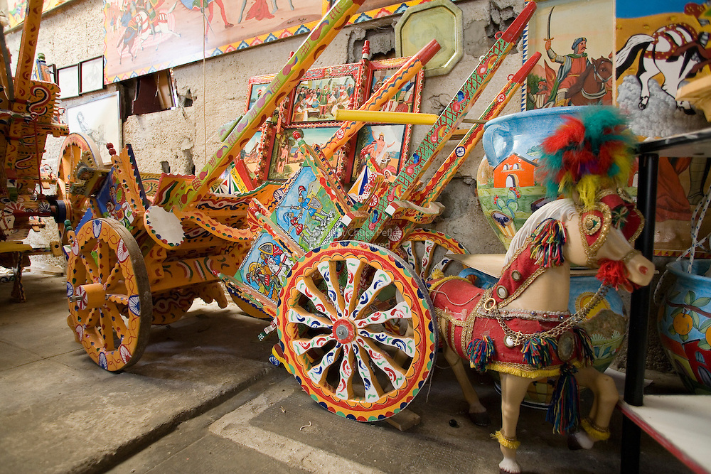 Traditional hand painted Sicilian carts in the workshop and studio of artist Franco Bertolino, Palermo, Sicily, Italy