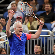 Tennis champion John McEnroe screams to the crowd as he plays during the PowerShares Tennis Series event at the Amway Center on January 5, 2017 in Orlando, Florida. (Alex Menendez via AP)