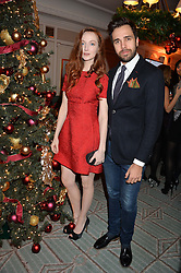 DIEGO BIVERO-VOLPE and OLIVIA GRANT at the Fortnum & Mason and Quintessentially Foundation Fayre of St.James's in association with The Crown Estate held at St.James's Church, Piccadilly followed but a reception at Fortnum & Mason, Piccadilly,London on 5th December 2013.