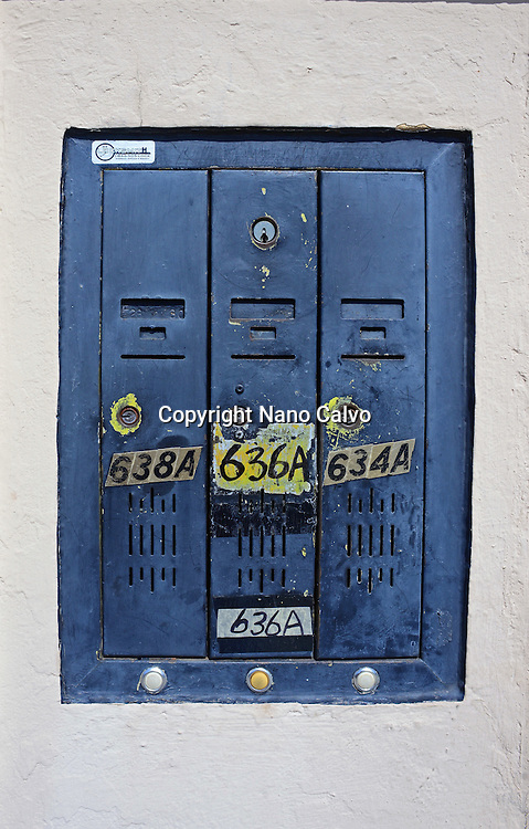Blue mailbox in apartment entrance.