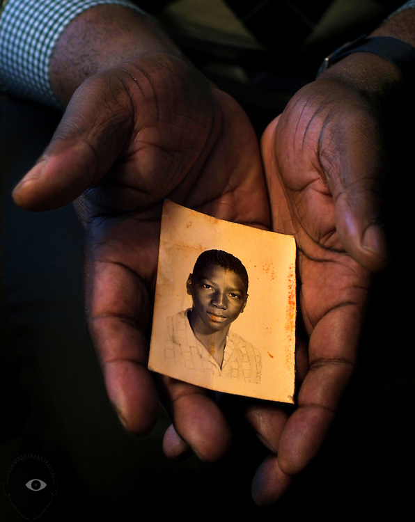 Chad Debnam cradles an old photo of his brother Clarence Debnam Jr. who was killed many years ago by a shotgun blast. Sadly, Chad just had his home and vehicle shot at and believes that racism is alive and well in Portland.