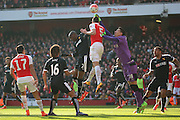 Watford goalkeeper, Costel Pantilimon (18) just beating Arsenal defender, Gabriel (5) to the ball during the The FA Cup Quarter Final match between Arsenal and Watford at the Emirates Stadium, London, England on 13 March 2016. Photo by Matthew Redman.