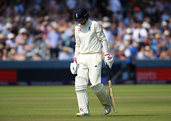 England's Joe Root walks off dejected after getting out during day three of the First NatWest Test Series match at Lord's, London.