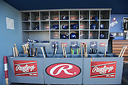 LOS ANGELES, CA - JUNE 17:  Baseball bats, batting helmets, and batting gloves are stored in dugout bins during batting practice before the Los Angeles Dodgers game against the Colorado Rockies at Dodger Stadium on Tuesday, June 17, 2014 in Los Angeles, California. The Dodgers won the game 4-2. (Photo by Paul Spinelli/MLB Photos via Getty Images)