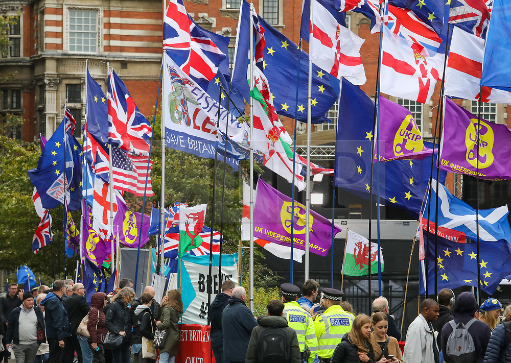 © Licensed to London News Pictures. 21/10/2019. London, UK. Flags blow in the wind outside Parliament as Speaker of the House John Bercow blocks Boris Johnson from having a meaningful vote on his Brexit deal today. Photo credit: Alex Lentati/LNP