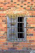 Metal bars on window with shutters in small town of Calzada Del Coto in Castilla y Leon, Spain
