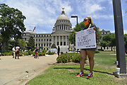 Today at the Mississippi State Capitol. Truth spoken to power by demonstrators in support of Black Lives Matter and against the brutal  murder of George Floyd and police brutality and systematic racism. In the past 6 days protests and riots have broken out across America in response to the brutal killing of an unarmed African American man by the knee and hands of Minnesota Police <br /> Officers. Photo copyright © @suzialtman #Suzi Altman #protest#peace #blacklivesmatter #georgefloyd #policebrutality #racism #america #mississippi #peacefulprotest #teachlovenothate