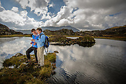 Hugh Thomson and son in the footsteps of Wainwright at Innominate Tarn, Lake District. Shot for BBC Countryfile magazine.
