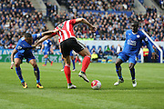 Leicester City defender Danny Simpson (17) and Southampton forward Graziano Pelle (19)  have a hold of each other during the Barclays Premier League match between Leicester City and Southampton at the King Power Stadium, Leicester, England on 3 April 2016. Photo by Simon Davies.