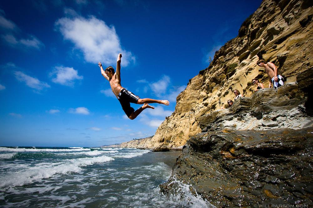 Marco Kengott, 15, enjoys high tide at Scripps Beach in La Jolla, California on August 09, 2008.