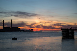 © Licensed to London News Pictures. 14/04/2015.  Thames estuary before sunrise. Tuesday 14th April got started with a deep Turneresque sky over the Thames estuary. Several days of good weather are predicted and Gravesend is often the location where the highest temperatures are recorded. Credit : Rob Powell/LNP