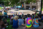 Athens Commnuity members listen to speakers following the city's  first PRIDE PARADE. The parade is part of Athens Pride Fest, a  week long celebration of solidarity, diversity, unity, and activism. Photo by Ben Siegel