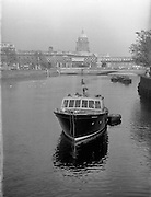 Two pictures of boat at O'Connell Bridge - Special for Mr Madden of Garryowen Transport - one side on and one from stern facing the bridge. <br />18/10/1958