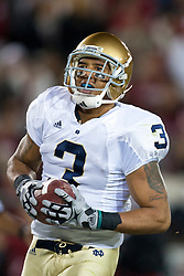 November 28, 2009; Stanford, CA, USA;  Notre Dame Fighting Irish wide receiver Michael Floyd (3) scores a touchdown against the Stanford Cardinal during the third quarter at Stanford Stadium.  Stanford defeated Notre Dame 45-38.  Mandatory Credit: Jason O. Watson-US PRESSWIRE