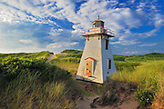 Lighthouse in sand dunes<br /> St. Peter's Harbour<br /> Prince Edward Island<br /> Canada