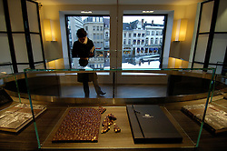 BRUSSELS, BELGIUM - JAN-13-2006 -  In a neighborhood otherwise given to art and antique galleries, Pierre MarcoliniÕs store, with its lean furnishings and black glass topped cabinets resembles more a Tiffany jewelry store than a chocolate shop. His chocolates, with their tiny gold lettering or gold filament decorations, evoke more microchips than Mars bars. (PHOTO © JOCK FISTICK)