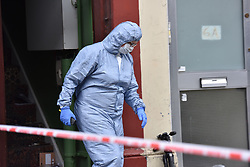 © Licensed to London News Pictures. 31/12/2018. West London, UK. Forensic officer leaving the property of a mass arrest. A man in his 30s was left fighting for his life after being stabbed on Fulham Palace Road in an unprovoked attack in the early hours of New Years Eve. Police have arrested 39 individuals at a party at a near by address where the assailant ran to following the attack according to eye witnesses. Photo credit Guilhem Baker/LNP