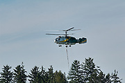 Forest Fire helicopter taking off, Comox, Vancouver Island, Canada   Photo: Peter LLewellyn