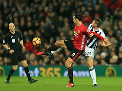 17 December 2016 - Premier League - West Bromwich Albion v Manchester United - Zlatan Ibrahimovic of Manchester United battles with Gareth McAuley of West Bromwich Albion - Photo: Paul Roberts / Offside.