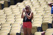 LOS ANGELES, CA - JULY 13:  A fan takes a photo before the Los Angeles Dodgers game against the San Diego Padres at Dodger Stadium on Sunday, July 13, 2014 in Los Angeles, California. The Dodgers won the game 1-0. (Photo by Paul Spinelli/MLB Photos via Getty Images)