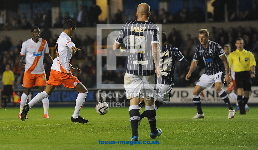 Picture by Daniel Hambury/Focus Images Ltd +44 7813 022858<br /> 17/09/2013<br /> Tom Ince of Blackpool scores his side's first goal during the Sky Bet Championship match at The Den, London.
