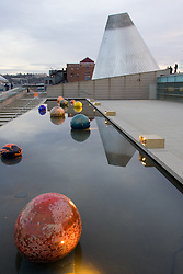 "Reflecting pool with glass balls, and cone of ""hot shop"" in Museum of Glass, Tacoma, WA, USA"