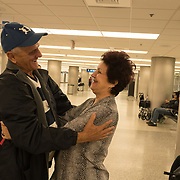 Pedro Ravelo of Cuba is greeted by his close friend Irene Heredia after he arrived at Miami airport, Florida, U.S. February 23, 2018. Picture taken February 23, 2018.  REUTERS/Angel Valentin