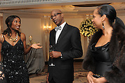 DENISE LEWIS; ED MOSES; MYRELLA MOSES, The Cartier Racing Awards. The Ballroom, Dorchester hotel. Park Lane. London. 15 November 2011. <br /> <br />  , -DO NOT ARCHIVE-© Copyright Photograph by Dafydd Jones. 248 Clapham Rd. London SW9 0PZ. Tel 0207 820 0771. www.dafjones.com.