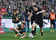 JOHANNESBURG, South Africa, 25 July 2015 : Ben Smith of the All Blacks kicks through a lost ball by Jesse Kriel of the Springboks during the Castle Lager Rugby Championship test match between SOUTH AFRICA and NEW ZEALAND at Emirates Airline Park in Johannesburg, South Africa on 25 July 2015. Bokke 20 - 27 All Blacks<br /> <br /> © Anton de Villiers / SASPA