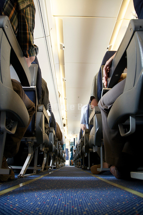 center aisle of an commercial airplane with view towards the front