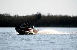 CANADA ALBERTA FORT CHIPEWYAN 12MAY07 - Speedboat with hunters on Quatrefouche River near Lake Athabasca...jre/Photo by Jiri Rezac / WWF-UK..© Jiri Rezac 2007..Contact: +44 (0) 7050 110 417.Mobile: +44 (0) 7801 337 683.Office: +44 (0) 20 8968 9635..Email: jiri@jirirezac.com.Web: www.jirirezac.com..© All images Jiri Rezac 2007 - All rights reserved.