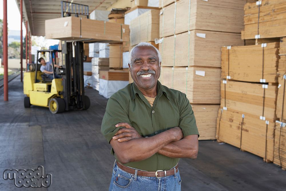 Warehouse Worker at Loading Dock of Lumber Warehouse