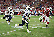San Diego Chargers inside linebacker Kavell Conner (53) runs with the ball after intercepting a second quarter pass that gives the Chargers first and ten at the Arizona Cardinals 12 yard line during the 2015 NFL preseason football game against the Arizona Cardinals on Saturday, Aug. 22, 2015 in Glendale, Ariz. The Chargers won the game 22-19. (©Paul Anthony Spinelli)